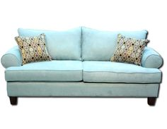 Home Furniture's Jubilee sofa collection is a soft, bright blue in a brushed microfiber fabric.  The accent pillows add multiple grays, blues, gold and purples in matelasse and chenille.  The large rolled arms are comfortable for leaning.  The softer shade of blue adds color to a room without being overpowering.
