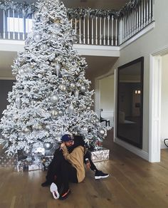 Kylie Jenner and Tyga Cuddle in Front of the Christmas Tree in Adorable Photo: 'All I Want for Christmas Is You' #kylie #jenner #cuddle…