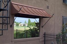 This is a great example of a residential copper awning, it brings so much character to the residence. Copper Awning, Metal Awning, Copper Roof, Exterior Trim, Exterior Doors, Entry Doors, Porch Awning, Restaurant Bathroom, Character Home