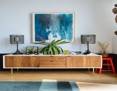 A large sideboard is the perfect place to put table lamps and some plants.