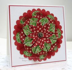 This is the Dahlia Fold using Be of Good Cheer designer paper, cherry tulle ribbon, antique brad, and Fancy Fan embossing plate on Whisper White with Riding Hood Red cardstocks. All supplies are Stampin' Up.