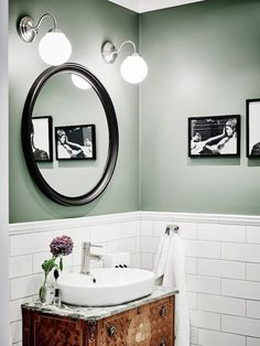 The white tiling, mixed shades of silver, exquisite lighting, and unique sink are making sage green look like an excellent candidate for any bathroom wall.