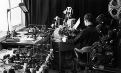 """Norman McLaren works on the editing of the film """"A Chairy Tale"""" using a Moviola editing machine, 1957 Advertising Techniques, 35mm Film, Back In The Day, Classic Hollywood, Great Photos, Norman, Filmmaking, Animation, Concert"""