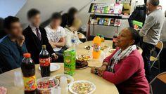 Christiane Taubira lors d'une visite dans les locaux de l'association Le Refuge le 11 mars 2013 (F. DURAND/SIPA)