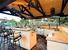 The most complete #outdoorkitchen I've seen.  It has everything that an indoor kitchen has, and more.  The best thing is the canopy with its ceiling fans.