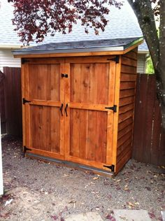 Completed 4x8 lean lean to backyard storage shed with barn door storage shed do it yourself home projects from ana white solutioingenieria Choice Image