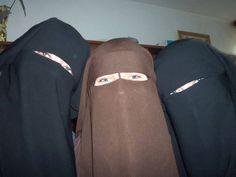 three ladies wearing the niqab