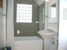i have always wanted a bathroom with a grey accent wall; but these grey subway tiles look much classier!