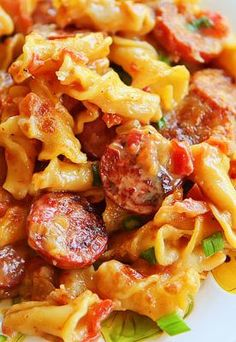 "Spicy Sausage Pasta. Another pinner said: ""My husband asked me to make this again FOUR times before we even got done eating!"""
