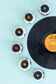 DIY Record Cupcake Toppers for a funky retro themed party. Cupcakes are fan favs and your guest will appreciate the fun accents.