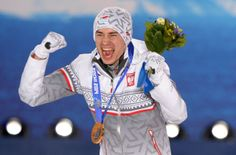 OLY-2014-SKIJUMP-MEN-MEDALS Sotsi Sotshi Sochi / Venäjä - 10.02.2014 A picture taken with a robotic camera shows Poland's gold medalist Kamil Stoch celebrating during the Men's Ski Jumping Normal Hill Individual Medal Ceremony at the Sochi medals plaza during the Sochi Winter Olympics on February 10, 2014.   Copyright: AFP / Lehtikuva Lähde: AFP Kuvaaja: Antonin Thuillier