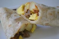 Mom On Timeout: Breakfast Burrito Bonanza.  These are now my go to recipe with a few tweaks.  I fry the bacon (1 pound) and remove it to drain. Cook the sausage (1 rolled pkg) and drain.  Then I scramble the eggs in the same skillet and add the meats back to the skillet and mix it up.  Layer cheese on the tortilla, then add the egg/meat mixture, and roll!  Delicious!