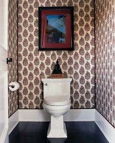 Bathroom with wallpaper by Katie Leede. Love the trim detail at the corners.
