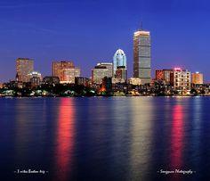 Boston city skyline at dusk by Songquan Deng, via Flickr
