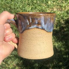 Blue drippy mug on speckled clay