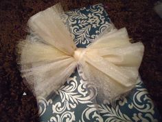 I make these poof bows for so many gifts! They're so simple and super cute! :) All you need is tulle and scissors! Here's how it works... F...