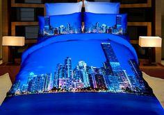 Ložní povlečení modré barvy s nočním velkoměstem u řeky