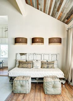 Old door, wall sconces, and reclaimed boards on the ceiling... love it!