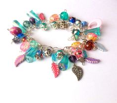 Silver colour bracelet with colourful beads and leaf charms.