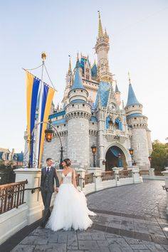 Disney Fairy Tale Wedding portraits in Magic Kingdom in front of Cinderella's Castle