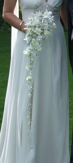 Ornate cascade trailing wedding bouquet of white dendrobium orchids, with crystal and bead accents. www.blackbaccara.co.uk