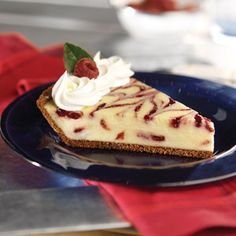 Streaks of raspberry preserves lend a festive touch to this cheesecake.
