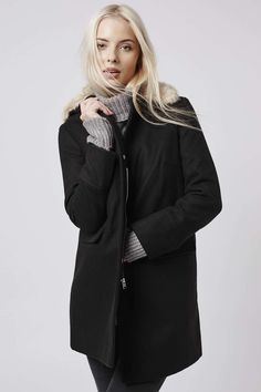 Borrow inspiration from the boys with this neat boyfriend style coat. Comes with a soft faux fur collar and clean, sleek lines. It features a front zip fastening and handy front pockets. #Topshop