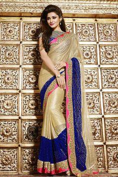 Crème Velours Et Net Art saris en soie de velours Blouse Prix:255,09 € Crème net , velours et de soie d'art sari avec velours bleu chemisier. Agrémentée brodé , Resham , Zari , la pierre et de la main . Saree vient avec un chemisier col rond .Il est parfait pour vêtements de sport , vêtements de fête , l'usure du parti et de l'usure de mariage . Blouse net velours tissu avec Art Soie…
