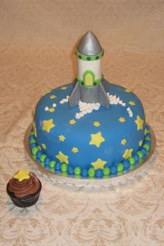 Rocket cake -  regular round cake with rocket molded out of Rice Krispies.