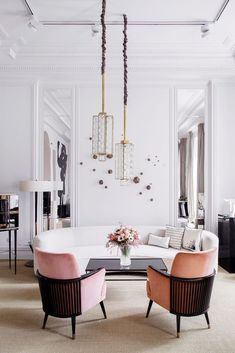 pink chairs with black wood backs in inspiring white living room. / sfgirlbybay