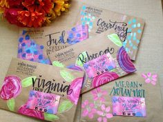 Painted envelopes with white ink overlay on brown paper bag background. SO freaking beautiful. So creative.