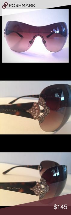 BVLGARI Limited Edition Crystal Shield Sunglasses Brand new with tags, 100% Authentic, BVLGARI Limited Edition Shield Women's Rimless Sunglasses decorated with silver metal elements and Swarovski crystals on acetate tortoise brown temples, 100% UV Protection with an adjustable bridge. Made in Italy.  Glasses do not come with a matching case and cleaning cloth. The same glasses are currently selling on eBay for $349.95. Bvlgari Accessories Sunglasses