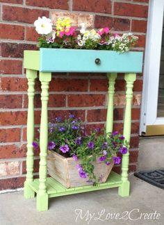 Old drawer and spindles turned very cool planter!