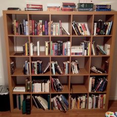 Ikea cube bookshelf. Free if you want it. All books shown are available too.