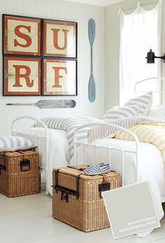 Surf's up in this bedroom... love the wicker storage trunks... great idea for the beach cottage look.