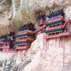 Monastery hanging 250FT above ground for over 1,600 years. This is true craftsmanship.