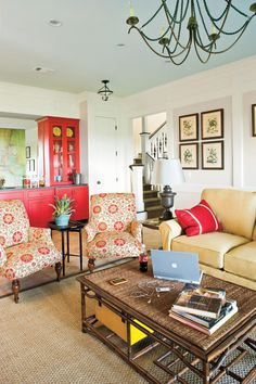 Use a fabric pattern to inspire the color scheme and style of your room. The fabric on these armchairs pulls together the tones of this living room.  See this Georgia Mountain Home