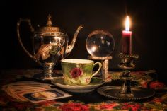 https://flic.kr/p/Tkd9jL | The teacup reader | Just seeing what kind of light I could get from using only candle light. I had to add extra candles that are outside the frame, and a white overhead reflector to get light onto the various objects