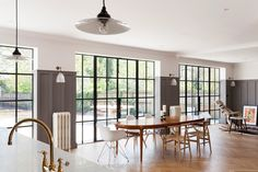 The dining area with Crittal-style steel-framed windows. - The dining area with Crittal-style steel-framed windows. Arts And Crafts Interiors, Arts And Crafts House, Orangerie Extension, Crittal Doors, Crittall Windows, Home Decoracion, 1920s House, London House, Modern Door
