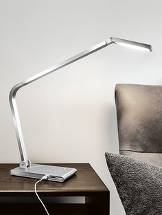 Our Reach LED table lamp is both a pleasure to look at and easy to use. Plus, Reach has two integrated USB ports for connivence. Modern Flooring, Modern Floor Lamps, Grey Flooring, Bedroom Flooring, Stone Flooring, Basement Flooring, Wood Linoleum Flooring, Terrazzo Flooring, Vinyl Flooring