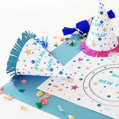 Happy New Year to you all! Party pretty with us & @marrylor   These party hats & placemats she created for us look so festive and all you need is a few sheets of blank paper to print on! A cheerful way to bring on 2016   #happynewyear #newyearparty #partyhat #partyhats #printable #printables #freeprintable #newyearparty2016