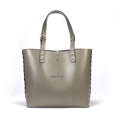 """The end all of carryalls, introducing the new Mohop tote! This classic catch-all was designed and engineered by an artist and an architect in the heart of Chicago. Hand riveted for superior quality, we use an ultra high-end vegan leather that we line with a soft-to-the-touch vegan suede. The faux leather backed shoulder strap has a comfortable 9.5"""" drop that is secured by hardcore hardware. This super spacious vegan tote is responsibly made, zero-cruelty and built to last.  Whether it ..."""