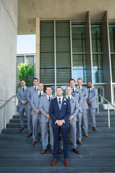We were thrilled to get Jonathan's groomsmen suited up in our textured gray suiting. Instead of finding suit or tuxedo rentals for his groomsmen, Jonathan outfitted his guys in textured gray three pie Blue Groomsmen Suits, Groom And Groomsmen Attire, Bridesmaids And Groomsmen, Blue Suit Groom, Groom Suits, Grey And Navy Blue Suit, Mens Suits, Groomsmen Outfits, Black Suits