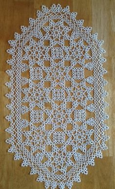 Tatted doily. Modified pattern from Tatted Treasures by Jan Stawasz.