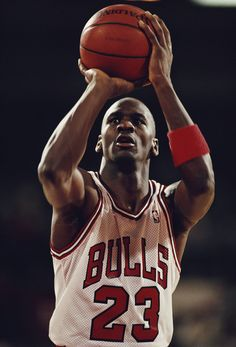 Michael Johnson shooting guard for the Chicago Bulls prepares to make a shot during a Central Division game in the Eastern Conference of the National Basketball Association (NBA) 1988 - 1989 season at Chicago Stadium, Chicago, United States. Nba Players, Basketball Players, Basketball Tattoos, Basketball Court, Basketball Shooting, Bulls Wallpaper, Michael Jordan Pictures, Bulls Team, Michael Jordan Basketball