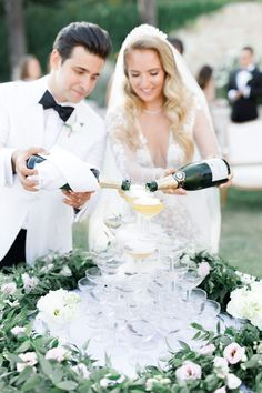 Add some luxury to your wedding by having a champagne tower. Italian Ruscus and white and blush lisianthus garland surrounding this Provence - French Riviera wedding at Chateau Saint Georges in Grasse Crystal Wedding Dresses, Wedding Flowers, Italian Ruscus, Reception Activities, Champagne Tower, Persian Wedding, Wedding Abroad, Destination Wedding Planner, French Riviera