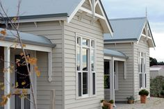 Weatherboard cladding bullnose verandah and windspray colorbond roofing