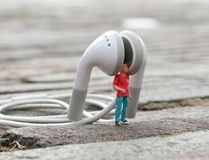"""Slinkachu became famous for his """"little people"""" project where he installed miniature models at various locations in London thereby creating a type of mini scenery."""