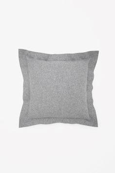 Raw-cut wool cushion