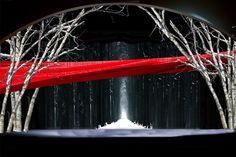 stage with white winter trees and red accent